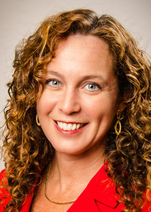 Picture of a woman with curly hair smiling